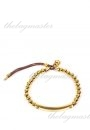 Michael Kors Logo Plaque Gold Tone Bead Stretch Bracelet