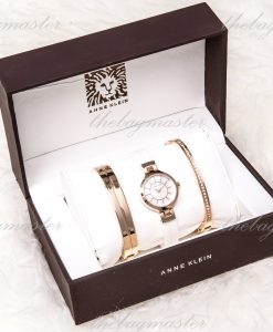 Anne Klein Women's AK/2048RGST Rose Gold-Tone and White Ceramic Bangle Watch with Two Coordinating Bracelets